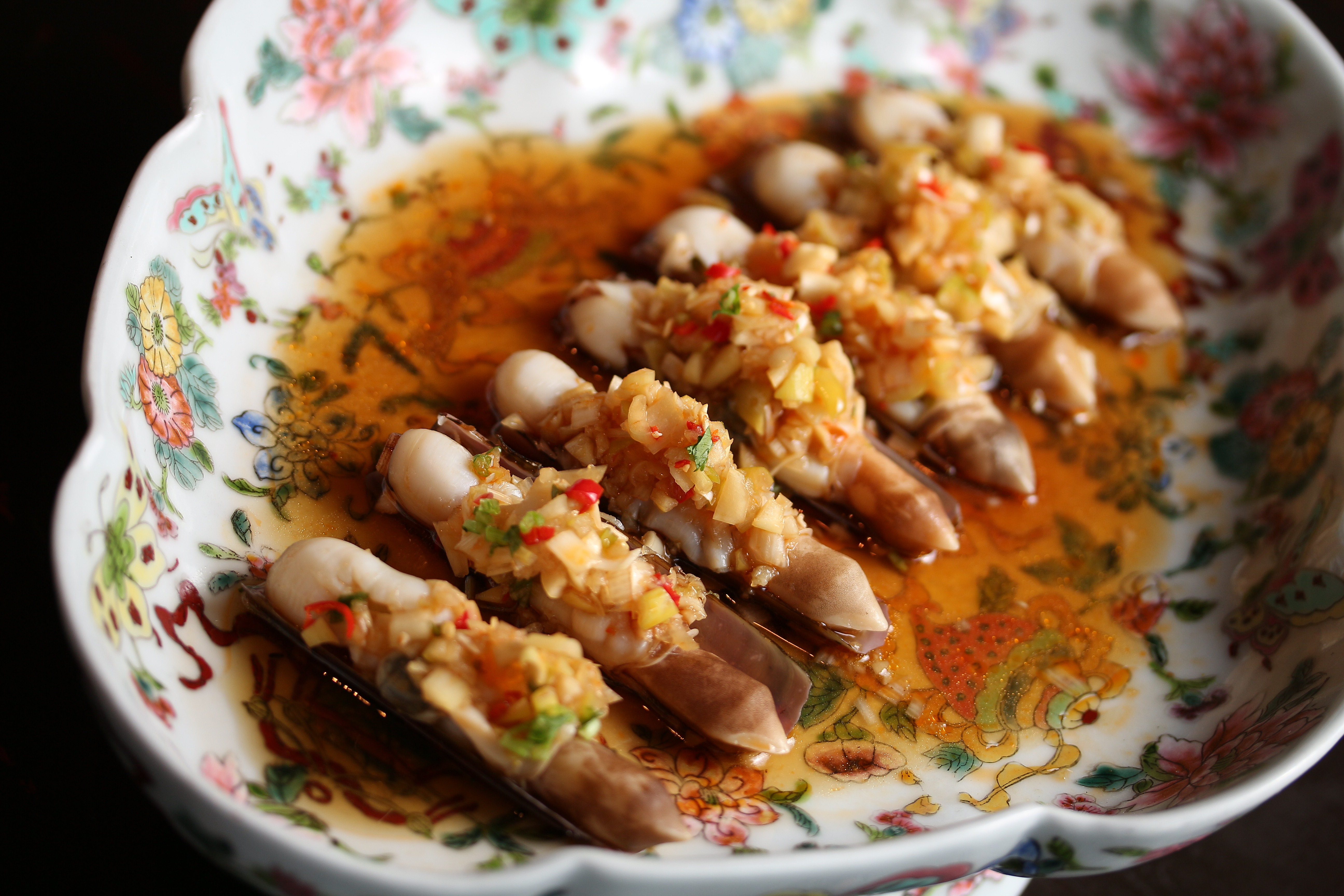 Chilled spiced razor clams steeped in Chinese rose wine