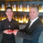 Hutong Operations Director Tony Geary handed staff red pockets containing a gift from the company.
